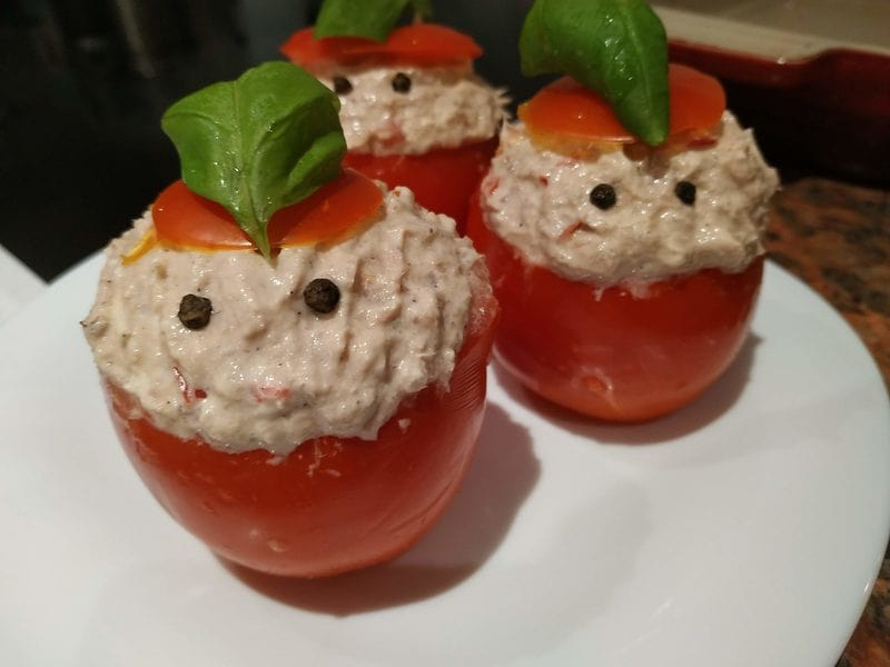 Add the tomato caps and decorate Cheese Cream Tuna Stuffed Tomatoes