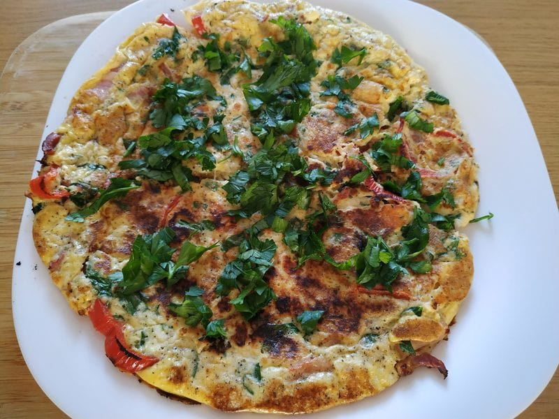 Cut the omelette in 4 quarters Greek Cheese and Parsley Omelette