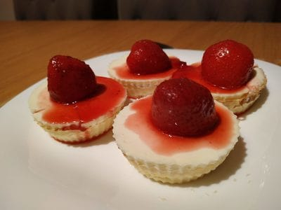 Add the strawberry sauce and strawberries Mini Strawberry Cheese Pies