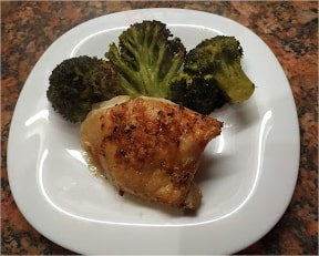 One roasted chicken thigh, roasted broccoli sprinkle with 1 tablespoon of grated mozzarella